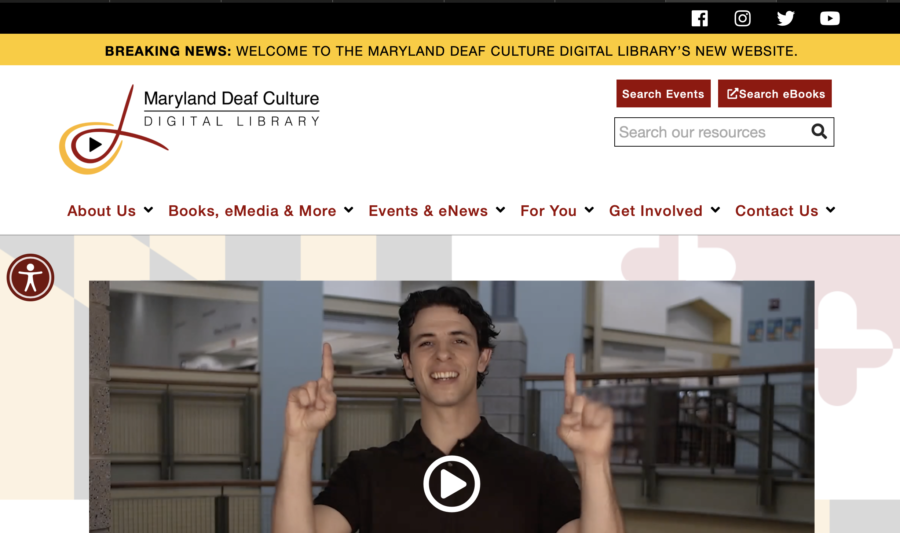 front page screenshot with menu, video still, and logo displayed for DCDL